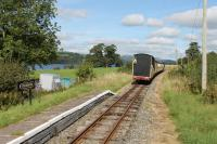 Summer lakeside scene on the Bala Lake Railway in 2016 as a train disappears towards Bala passing through Pentrepiod Halt. <br><br>[Mark Bartlett&nbsp;17/09/2016]