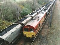 Loaded and empty coal trains hauled by EWS class 66 locomotives pass at the north end of Millerhill Yard in September 2000 on the busy coal route between the Edinburgh sub and the ECML. The loaded train is hauled by 66049, with 66164 approaching at the head of the empties.<br><br>[John Furnevel&nbsp;11/09/2000]