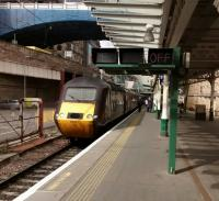 After a symphony of whistling and door banging HST 43 321 heads 'OFF E' on<br> the morning of 1 June. To the left can be seen the site of the covered<br> siding, next to the basement of The Scotsman building, where newspapers<br> were loaded overnight.<br><br>[David Panton&nbsp;01/06/2017]