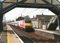 An afternoon Virgin Trains East Coast service runs south through Prestonpans station on 7 September 2016.<br><br>[John Furnevel&nbsp;07/09/2016]