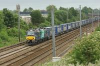 DRS 88003 heads north between Leyland and Farington Jct with the Daventry to Mossend 'Tescoliner' on 12 June 2017. This was the first northbound working on this container service with one of the new Class 88 locomotives.<br><br>[John McIntyre&nbsp;12/06/2017]