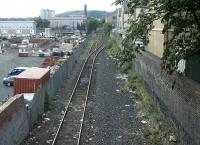 The Powderhall branch looking south east from Powderhall Road towards Leith Walk in the summer of 2004, with the next phase of development about to get underway on the left [see image 13871].<br><br>[John Furnevel&nbsp;/07/2004]