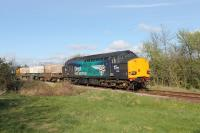 With new DRS locos being delivered in 2017 the days of the Class 37 fleet are perhaps numbered. Almost looking like it is posing for its picture, EE Type 3 37069 brings up the rear of a Heysham to Sellafield flask train using the single track Bare Lane to Hest Bank chord on 12th April. Lead loco was classmate 37059.<br><br>[Mark Bartlett&nbsp;12/04/2017]