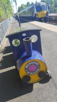 Barrel train and real train at Milngavie. [John noted there should be a plaque - an overly detailed page on the Milngavie line was the first page on RailScot. -Ed]<br><br>[John Yellowlees&nbsp;18/05/2017]