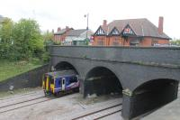 A Blackpool North to Huddersfield service passes over newly relaid tracks as it slows for the Poulton stop on 6th May 2017. The station ticket office and main entrance can be seen on top of the bridge. Catenary will be erected here during the next twelve months.<br><br>[Mark Bartlett&nbsp;06/05/2017]