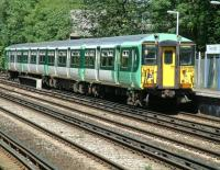 Southern trains 455838 arrives at Penge West on 12 July 2002. The train is operating a service from London Bridge to Caterham via Forest Hill<br><br>[Ian Dinmore&nbsp;12/07/2002]