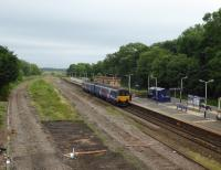 Transformation at Kirkham. All traffic is presently concentrated on the two platform lines as the fast lines were recently lifted. A third platform is planned here as part of the electrification work. 150150 calls on a Blackpool North to Manchester service on 16th June 2017. [See image 22070] for an earlier view from the same vantage point.<br><br>[Mark Bartlett&nbsp;16/06/2017]