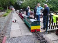 <I>Battery or Steam power?</I> Discussion on the relevant motive power merits at the Cinderbarrow Miniature Railway during a private evening visit in June 2017. The resident Bo-Bo BE, loosely resembling a Class 58, has 3x8v batteries and a 1hp motor on each axle so has real pulling power. View across the station site towards the signal box.<br><br>[Mark Bartlett&nbsp;14/06/2017]