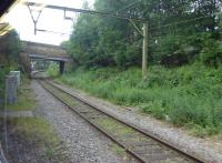 Grab shot from a Hadfield train of the <I>main line</I> platform at Dinting on 16th June 2017. This platform is still used by a few rush hour trains but the majority avoid this chord to access the Glossop branch on the other two sides of the triangle. Dinting signal box, which controls trains in the Glossop and Hadfield area, can just be seen beyond the bridge [See image 42379]. <br><br>[Mark Bartlett&nbsp;16/06/2017]