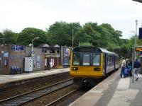 Northern Pacer 142056, working from New Mills Central to Manchester Piccadilly, pulls in to the first stop at Marple on 16th June 2017. These South Manchester services were the last refuge of the 1st Generation Met-Cam DMUs [See image 12896] but then went over to Pacer operation. What will be cascaded next? <br><br>[Mark Bartlett&nbsp;16/06/2017]