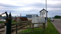 Forres East Signal Box, looking east. The box looks out on a large pile of new sleepers - part of the scheme which will soon see it superfluous and swept away. <br> <br><br>[Alan Cormack&nbsp;21/06/2017]