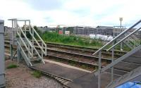 Stairs by the East box at Forres on 21 June 2017. On the right are the signal box access steps, to the left those for catching tablets from westbound trains, with the equivalent for eastbound trains across the tracks. In the background are the works associated with the new station and loop.<br><br>[Alan Cormack&nbsp;21/06/2017]