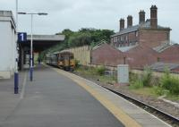 A Blackpool to York service waits in Platform 1 at Blackburn while a Clitheroe service clears the short section to Daisyfield Junction. The original station building can be seen on the right contrasting with the newer platform buildings. [See image 51349] for an exterior view. .<br><br>[Mark Bartlett 16/06/2017]