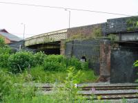 This is the site of Golborne South station, on the WCML which closed in 1961. The old ticket office was in the bricked up section of the bridge above the pier and the station footbridge (the lattice structure crossing the slow lines) has been modified post electrification and recommissioned to carry the southerly footpath of the A573.<br> <br><br>[Michael Butterworth&nbsp;16/06/2017]