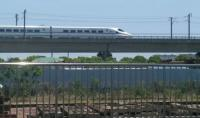 Grab shot of a 16 car CRH2 train speeding south on the Shanghai-Hangzhou High Speed railway in the direction of Hangzhou in Zhejiang Province.  Taken from train C3659 at Xinqiao Station heading from Shanghai South to Jinshanwei.<br><br>[Mark Poustie&nbsp;29/05/2017]