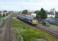 A four car Pacer train slows for the Kirkham stop with a Blackpool North to Hazel Grove service on 16th June 2017. Alongside the surviving running lines work is taking place on the site of the recently lifted fast lines in connection with electrification and Kirkham's new third platform. <br><br>[Mark Bartlett&nbsp;23/06/2017]