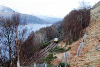 A Network Rail landrover heads south alongside Loch Treig in 2013. This may have been to check on the condition of the derailed locomotive, about a mile further south.<br><br>[Ewan Crawford&nbsp;12/02/2013]