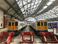 Northern Class 319 nos. 367 and 361, still in their white base livery with blue doors, seen at Lime Street's Platforms 1 and 2 in June 2017.<br><br>[Colin McDonald&nbsp;20/06/2017]