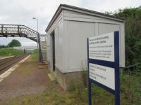 The timber shelter at Breich alongside the low platforms and the aged footbridge, whose need for replacement has prompted the decision to seek approval for closure. <br><br>[John Yellowlees 27/06/2017]
