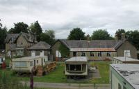 The old station at Middleton-in-Teesdale closed in 1964 and has since become a caravan site with the station building in use as a site office. The static caravans in the foreground occupy the old trackbed with the remains of the platform, station building and station house behind. 26th June 2017. <br><br>[Mark Bartlett&nbsp;26/06/2017]
