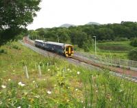 With the Eildon Hills forming the backdrop, an Edinburgh bound train on the Borders Railway comes off the Red Bridge over the River Tweed and runs past a meadow of wild flowers.  The attractive lochan on the right is part of Scottish Water's Galashiels sludge treatment works. (Sorry about that last bit)<br><br>[John Furnevel&nbsp;16/06/2016]