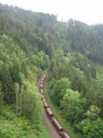 A DB ballast train weaves its way north towards Triberg on the<br> Schwarzwaldbahn on 1st June, part-way along the dramatic looping alignment required for the railway to reach the watershed between rivers flowing to the Rhine and to the Danube. The photographer took this shot from the purpose-built panoramic viewpoint shown on the side of the loco in [See image 59822], and he saw the ballast train at four different locations above and<br> below him within the space of less than 10 minutes (but poor light precluded<br> more than one decent shot).<br> <br><br>[David Spaven&nbsp;22/06/2017]