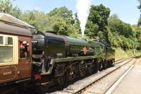 35006 <I>Peninsular & Oriental S. N. Co</I>, a Rebuilt Bullied Merchant Navy 4-6-2, waits to leave Medstead & Four Marks station during the Mid-Hants gala marking the fiftieth anniversary of the end of Southern steam. 2nd July 2017<br><br>[Peter Todd&nbsp;02/07/2017]