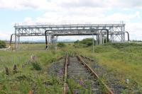 The view looking south along the mothballed Seal Sands branch in June 2017, taken from the level crossing near the actual junction where trains reversed. [See image 59796] for the (broadly similar!) view of the railway in this industrial landscape in the opposite direction. <br><br>[Mark Bartlett&nbsp;24/06/2017]