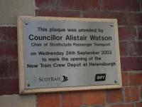 This plaque was unveiled by Councillor Alistair Watson at Helensburgh Central to mark the opening of a new train depot. His funeral will be held on the 6th of July 2017.<br><br>[John Yellowlees&nbsp;24/09/2003]