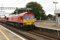 DBS 66136, westbound through Didcot with a rake of stone empties bound for the Somerset Quarries on 15th June 2017. This engine hauled the first London to China freight train recently.<br> <br><br>[Peter Todd 15/06/2017]