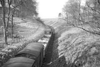 View west from the road bridge at Gordon looking towards Earlston on a fine day during the Easter holiday in 1965. The branch pick up goods is on its way back from Greenlaw to St Boswells, with the locomotive propelling two wagons to be deposited at Earlston sawmill on the way home. [See image 22900]<br><br>[Bruce McCartney&nbsp;//1965]
