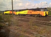 Colas Rail 70.807 and a classmate bask in the sun at Westbury. The livery may be bright, but it doesn't actually make up for the (lack of) styling.<br><br>[Ken Strachan&nbsp;13/05/2017]