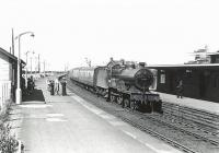 A Saturday Darvel - Ayr train, hauled by 2P 4-4-0 40645, arrives at Newton-on-Ayr on 4 July 1959.  <br><br>[G H Robin collection by courtesy of the Mitchell Library, Glasgow&nbsp;04/07/1959]