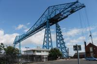 Middlesbrough's famous transporter bridge on 24th June 2017, when it was unfortunately out of service awaiting repairs. By one of those strange coincidences my first visit to this location was eight years to the day that I had visited its sister bridge at Rochefort in France [See image 24425]. The sturdy cables dropping vertically from the ends of the bridge are anchored deep underground to hold the cantilevered deck in tension.<br><br>[Mark Bartlett&nbsp;24/06/2017]