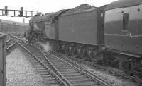 An ECML service leaves Newcastle in 1960 and heads for the King Edward Bridge. At the head of the train is 60111 <I>Enterprise</I>. The A3 Pacific was a resident of Grantham shed, from where it was eventually withdrawn at the end of 1962.  <br><br>[K A Gray&nbsp;//1960]