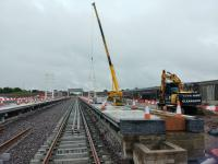 The new station site is progressing well, platforms are nearly complete, the footbridge is being erected and track laid. This view looks west.<br><br>[Alan Cormack&nbsp;07/07/2017]