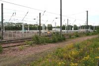 Construction of stabling roads and erection of catenary associated with the new Millerhill electric train depot well advanced on 9 July 2017. View south east over the freight-only lines, with the Borders Railway behind the camera. <br><br>[John Furnevel&nbsp;09/07/2017]