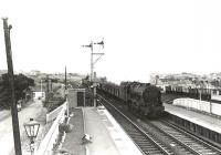 A down coal train about to run through Auchinleck station on 29 July 1961. The locomotive is Royal Scot 46121 <I>Highland Light Infantry, City of Glasgow Regiment</I>.<br><br>[G H Robin collection by courtesy of the Mitchell Library, Glasgow&nbsp;29/07/1961]