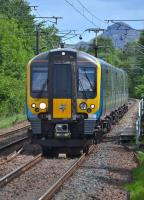 FTPE 350404 approaches Kingsknowe with the 12.13 Edinburgh - Manchester Airport service on 3 July (... almost an Alpine feel?)<br><br>[Bill Roberton&nbsp;03/07/2017]
