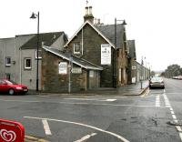 The former Kirkcudbright station, looking north along the A711 Saint Mary Street in November 2005, some 40 years after closure. Housing now covers the site of the former platforms but the main station buildings still survive.<br><br>[John Furnevel&nbsp;22/11/2005]