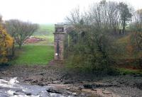 Remains of Tongland Viaduct on the east side of the River Dee in November 2005. Rubble from the demolished main sections of the former bridge can be seen in the field alongside.<br><br>[John Furnevel&nbsp;18/11/2005]