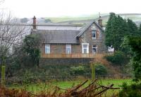 The surviving main building of the former station at Tarff on the Kirkcudbright branch in November 2005, more than 40 years after closure of the line. View is east across the A75 road.<br><br>[John Furnevel&nbsp;09/11/2005]