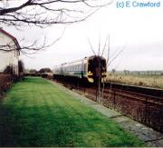A speeding along passenger train passes Watten on the way to Georgemas from Wick.<br><br>[Ewan Crawford&nbsp;//]