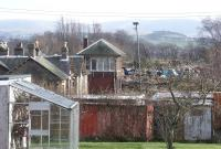 Looking east along the trackbed at Biggar in February 2004 with housing developments and a scrapyard gradually encroaching on the site of the old station.<br><br>[John Furnevel&nbsp;09/02/2004]