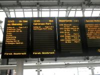 Departure board at Ayr station on 2 March 2012 showing the 12.45 direct coach link with the ferry terminal at Cairnryan.<br><br>[John Yellowlees&nbsp;02/03/2012]