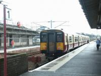 Work in progress on the building on the north side of Lanark station in March 2003, as a train for Dalmuir awaits its departure time at platform 1. <br><br>[John Furnevel&nbsp;16/03/2003]