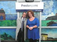 The new mural by Adele Conn was officially inaugurated at Prestonpans station on 2 October 2011 by Councillor Willie Innes. The photograph shows Councillor Innes with Adele Conn in front of the completed work (refer previous news item dated 18 September 2011). [See image 34627].<br><br>[John Yellowlees&nbsp;02/10/2011]