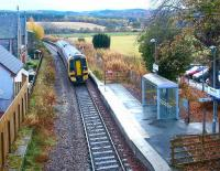A Kyle of Lochalsh - Inverness train leaving Beauly in 2003, showing part of the original station building on the left.<br><br>[John Furnevel&nbsp;23/11/2003]