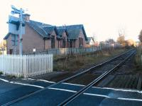 The former Inverness & Ross-shire 1862 station at Bunchrew looking east towards Inverness over the open level crossing in November 2003. The station was closed to passengers in June 1960.<br><br>[John Furnevel&nbsp;24/11/2003]