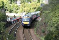 A Fife Circle train rounds the curve on the southern approach to Burntisland station on a sunny May morning in 2005.<br><br>[John Furnevel&nbsp;26/05/2005]